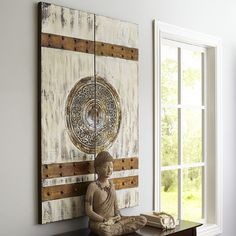 In ancient Chinese culture, lacquered red doors (called a vermillion gate) represented great wealth and luck. In modern living room culture, since the look proved popular with Pier 1 customers, we decided to add an ivory theme to the hand-painted wood and cotton canvas art—for good measure.