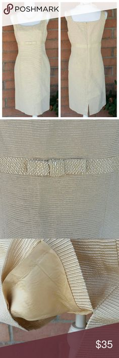 """Tahari Arthur S. Levine Sz 14 Dress Beautiful Sz. 14 Cream color dress with accent beading around the waist. This material has a shine to it. Fully lined inside. Dress is a Cotton / Poly blend.  Threads on one side of the bow has come loose. Easy fix *See Pic*  Measurements:          Chest     20""""                                       Waist     19""""                                       Length   39""""  Note* Dress was pinned to fit mannequin for pictures Tahari Arthur S. Levine Dresses Midi"""