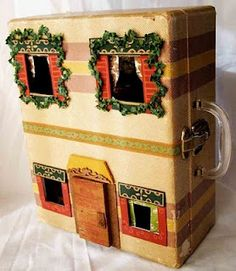 Elizabeth Abernathy: suitcase turned into a doll house. Claire would think this is cool.
