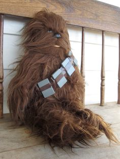 Chewbacca plush - my other best friend. I used to bend him inhalf and use him as a ironing board in my playpenthouseapartment!
