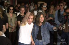 Angus Young, Malcolm Young at the ceremony where they were inducted into Sunset Blvd's Rockwalk. 09-15-00