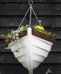 I will have a hanging boat planter in the backyard.