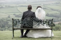 The bride and groom sat having a moment to themselves whilst looking out over the fields behind Northcote Manor, North Devon.