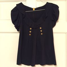 Anthropologie Leifsdottir Navy Blouse This navy colored blouse features a fun ruffle collar and gold buttons to accent the front. It looks great on and is soft material! It was only worn a couple of times so it's in great condition! Make an offer ✅ Anthropologie Tops