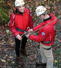 Prince William also got involved and is seen here, left, helping his wife, the Duchess of ...