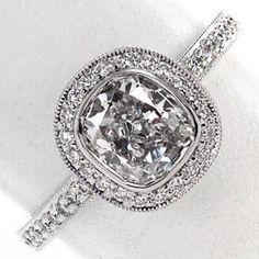 Yep! Bezel set cushion cut diamond engagement ring with diamond halo & diamond pave band