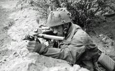 """Private Joe Cunnington, of the Border's Anti-Tank Platoon and from the crew of """"Gallipoli II"""", in his foxhole among the positions of """"C"""" Company training his Sten gun in anticipation of another German assault on his position, possibly on the Van Lennep British Soldier, British Army, Military Photos, Military History, Operation Market Garden, Parachute Regiment, Man Of War, Story Of The World, German Army"""
