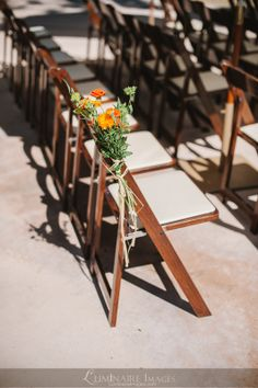 Ceremony aisle summer decor of orange, pink, and green at Forest ...