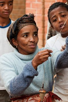 Artisan in Madagascar spins silk into thread. Madagascar, Black People, Real People, Salt Of The Earth, Island Nations, Raw Beauty, Animal Species, Places Of Interest, My Heritage