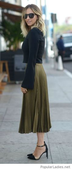 Black blouse and shoes with olive midi skirt