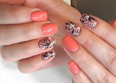 Two-colors nail art: orange and black nails with rhinestone