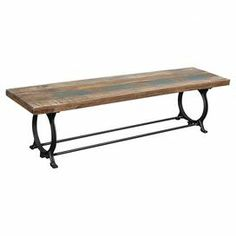 """Reclaimed wood bench with an ironwork base.  Product: BenchConstruction Material: Reclaimed wood and ironColor: Natural and multiFeatures:Distressed finishOpenwork iron baseDimensions: 17.5"""" H x 70"""" W x 17.5"""" D"""