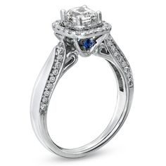 a vera wang engagement ring. so lovely. the hidden sapphire makes the ring even more special. i have never seen another ring this amazing!