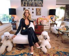 Jonathan Adler says everyone looks good next to a white poodle. She is chic and…