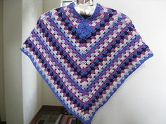 Free Pattern Crocheted Poncho with blossom by DROPS design