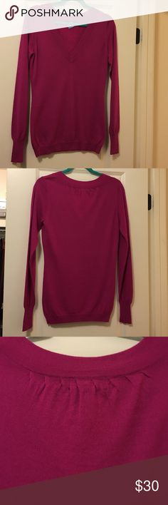 Magenta V-Neck Sweater Lightweight v-neck sweater with ribbed sleeves and feminine detail at back of neck. Great for layering. 50% merino wool, 50% acrylic. Excellent condition. Dry cleaned. The Limited Sweaters V-Necks