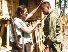 Nieves Fernandez, the only known Filipino female guerilla leader shows US Army Pvt. Andrew Lupiba how she used her long knife to silently kill Japanese soldiers. - pin by Paolo Marzioli Filipino Art, Filipino Culture, Mahal Kita, Collections D'objets, Philippines Culture, Manila Philippines, Leyte, Colorized Photos, Show Us