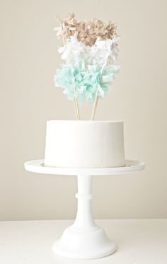 """For trend-savvy parties, party people, and celebration cakes that don't care to know the definition of """"understated"""" : Multi-Fringe-Garland Cake Topper. plain white or piped cake with easy homemade toppings. Wedding Cake Toppers, Cupcake Toppers, Cupcake Cakes, Wedding Cakes, Cake Banner, Cake Bunting, Carrot Cake Cheesecake, Birthday Parties, Birthday Cake"""