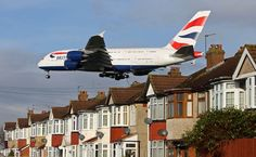 A380 lands over houses in Myrtle Avenue near Heathrow airport.