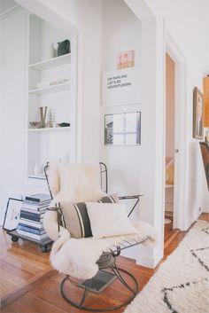 Victoria Smith of @sfgirlbybay / victoria smith // wall art // white // wire chair // throw pillows // photography by @Edyta Szyszlo