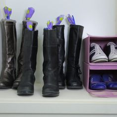 Use a pool noodle cut to size to keep your boots standing straight up. These pool noodles were finished with some material and ribbons to tie the ends. Shoe Hanger, Shoe Rack, Stone Spray Paint, Shoe Drawer, Deep Closet, Master Closet, Hanging Shoe Organizer, Shoes Organizer, Hanging Shoes