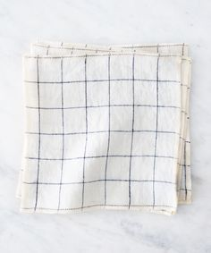 Ivory linen napkins with a simple navy windowpane pattern and our light  peach edge add a simple sophistication to your everyday. Cut with intention  to a 7-inch square, our Signature Napkins are perfect for casual dining,  snacks, breakfast, and no-waste lunches at home and on-the-go.  Mix and