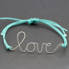 Use a paperclip and jewelry pliers to make this adorable DIY love bracelet! Wire Jewelry, Jewelry Crafts, Jewelery, Jewelry Rings, Diy Love, Do It Yourself Jewelry, Homemade Jewelry, Bijoux Diy, Schmuck Design