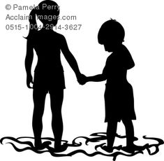 silhouette of two kids holding hands at the beach
