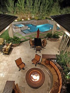 Fire pit bench seating and pool. Dream backyard.