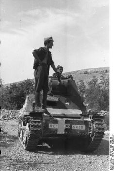 "Soldiers with an Italian tank , the ""Carro Armato L"". Balkans. Jugoslavia.  August 1943"
