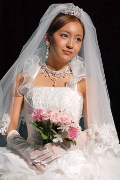 "AKB48's Itano Tomomi in wedding dresses for ""Scena D'uno"""