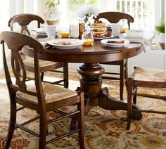 arlington round sienna pedestal dining room table w chestnut finish. like the table for breakfast room. ~tivoli extending pedestal dining (table with margaux chairs and all discounts would be arlington round sienna room w chestnut finish u