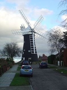 Holgate Windmill is a tower mill at Holgate in York, North Yorkshire, England which has been restored to working order. It was built in 1770 of brickstones by its first owner & miller George Waud. He, his son & grandson ran the mill until 1851, & a dwelling-house was erected around the same time. The mill was originally fitted with five Roller Reefing sails although these were later replaced by Double Patent sails.
