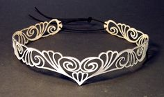 "Head wreath in white leather ""Nouveau Deco"". $29,00, via Etsy."