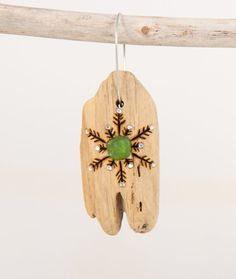 Driftwood Christmas Ornament with Wood Burned Snowflake adorned with jewels and green sea glass by OnceUponAShore