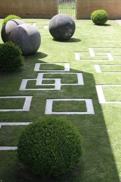 Garden design by Michael McCoy. Love the contrasting shapes and balance!