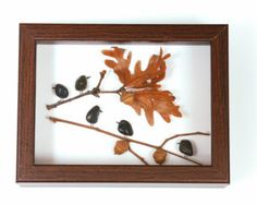 This beautiful handmade work of art is composed with smooth black river rocks with no two being the same. The person swings gently from a tree branch displayed on a white mat board background. This delicate image is simple but calming. It is showcased inside a white-framed shadow box. This interior dimensions are 8.75x6.75 and the overall product is 10x8 and is 1.25 thick. This unique and one-of-a-kind piece is sure to impress.