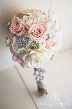 Love the pastel colors and silver hints of this bouquet! #wedding #inspiration #flowers #bouquets