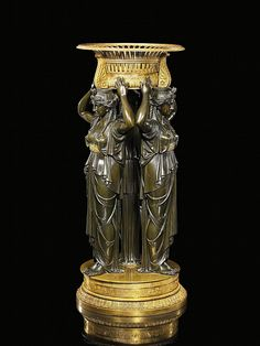 Surtout De Table Aux Victoires. <br>Paris. Around 1820. Design presumably by Gérard-Jean Galle. <br><br>Bronze, partially patinated and gilt. Circular base. Height 67cm. Condition B. <br>Literature: