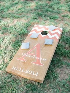 peach and white chevron cornhole game