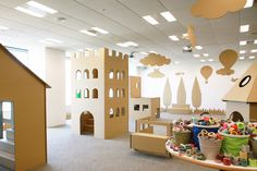As part of a promotion for a Japanese masking tape manufacturer, art director Koji Iyama constructed a cardboard city and invited children to decorate. Kindergarten Interior, Kindergarten Design, Cardboard City, Cardboard Box Crafts, Kids Cafe, Indoor Playground, Kids Store, Kid Spaces, Masking Tape