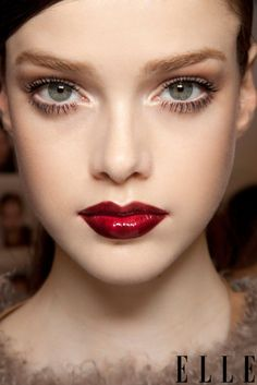 Wet deep red lips and pretty eyes