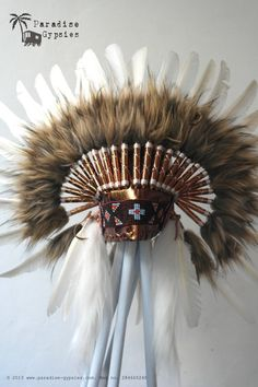 All White Swan Feather Headdress On Soft Metallic Gold Leather by ParadiseGypsies     Ha I found this while searching, and fuck me would I love this, lol