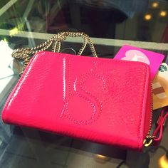 VS Mini Crossbody/Wallet Really beautiful item • one part crossbody, one part wallet • long gold tone chain link strap that is removable • cheetah print interior • inside pocket fits an iPhone 5 without the case Victoria's Secret Bags Wallets