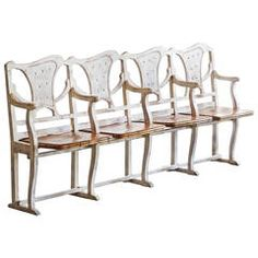 Antique Cottage-Style Row of Theater Seats with Crest Design