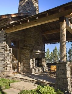 """Rustic """"end porch"""" with field stone fireplace in this Montana log home"""