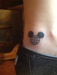 vintage mickey with the epcot symbol inside! OH MY GOSH!!! I WANT THIS TAT!!! its a mickey AND Epcot!!