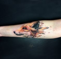 Fox head tattoo on the right inner forearm.