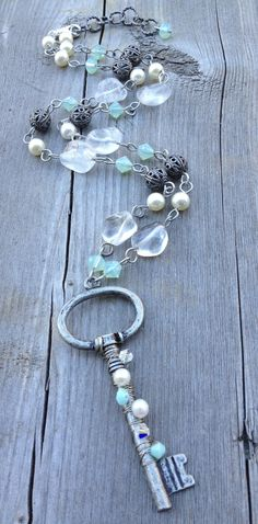 Custom skeleton key necklace. Beachy, rustic feel with Quartz nuggets, Swarovski crystals and pearls. Visit www.sarahreiddesigns.com for more about me and my handmade jewelry