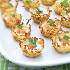 This smoked salmon appetizer uses just a small amount of smoked salmon to increase the flavor in the creamy filling of the bite-sized potato nests.